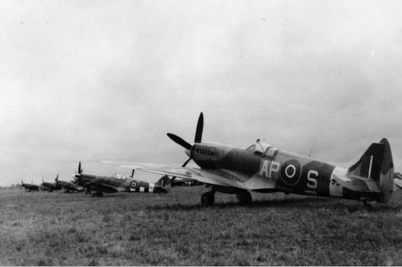 Supermarine Spitfire Mark XIVs (RM693 'AP-S' nearest) of No 130 Squadron RAF, on the ground at B82/Keent.